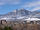 snow covering the Flatirons and the University of Colorado Boulder campus