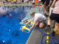 a student launches his team's ROV in the pool