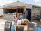 a convenience store on the refugee camp's street