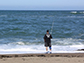 a man on the beach fishing